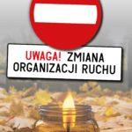 """obrazek przedstawia palący się znicz stojący an jesiennych złotych liściach. Nad zniczem znak zakaz wjazdu i napis: """"UWAGA! ZMIANA ORGANIZACJI RUCHU"""""""